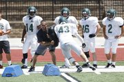 Free State High assistant football coach Brett Oberzan works with defenders, Thursday, June 12, 2014, at FSHS.