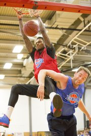 Ben McLemore brings down the house as he slams home a monstrous dunk over Brady Morningstar during the annual Rock Chalk Roundball Classic, played Thursday evening at Lawrence High.