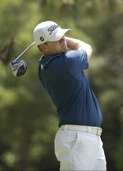 Former Kansas University golfer Chris Thompson watches his tee shot on the second hole during the first round of the U.S. Open golf tournament in Pinehurst, N.C., Thursday, June 12, 2014.