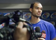 Kansas University junior Perry Ellis talks to the media, Tuesday, June 17, 2014, about KU's selection as the team to represent the United States in the 2015 World University Games in Korea.