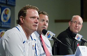 Kansas University men's basketball coach Bill Self, left, discusses KU's selection to represent the United States in the 2015 World University Games, Tuesday, June 17, 2014, at KU. Joining Self at the news conference were KU athletic director Sheahon Zenger, center, and Craig Jonas, the deputy head of the USA delegation for the Games.