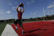 Lawrence High receiver Coulter Strauss catches a pass in the end zone as he and his teammates practice during football camp on Wednesday, June 18, 2014 at Lawrence High School.