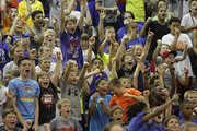 Bill Self Basketball Camp participants celebrate a win by a camp team in a game against counselors during a scrimmage at the, Wednesday, June 18, 2014, at the Horejsi Center.