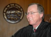 Douglas County District Judge Michael Malone will retire in August after more than 30 years of service.