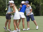Himawari Ogura, right, hugs her golfing partners after Ogura wrapped up a win in the girls AJGA Gary Woodland Championship event Thursday at Alvamar. Ogura shot a 69 on Thursday and 3-over-par for the three-day tournament.