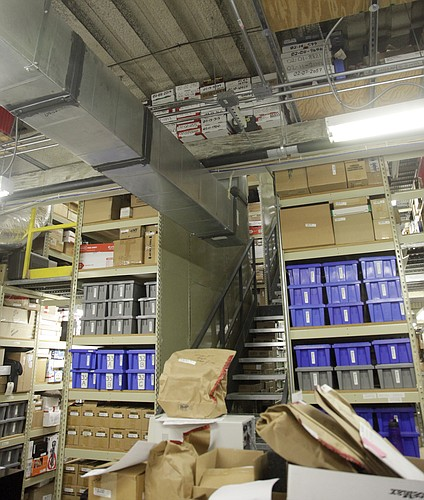 A mountain of boxes fill the main evidence storage room on the second floor of the Judicial and Law Enforcement Center, 111 E. 11th Street. The room is in the former gym from when that part of the building was a jail, and it now includes a steel staircase for two makeshift floors inside.