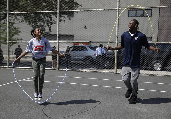 Kansas' Andrew Wiggins jumps rope with a student during a kids basketball clinic in New York, Wednesday, June 25, 2014. Wiggins and other 2014 draft prospects are in town for the NBA draft in Brooklyn, New York on June 26, 2014.