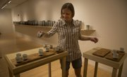 """Kyla Strid sets up her exhibition """"Waggle Dance"""", which opened Friday at the Lawrence Arts Center."""