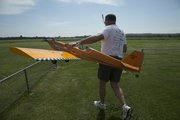 Greg Kloepper, of Lawrence, walks his SIG 4-star 60 to the runway for a flight.