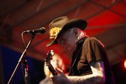 Legendary blues player Johnny Winter performs during a free concert Wednesday night outside of the Lawrence Arts Center.