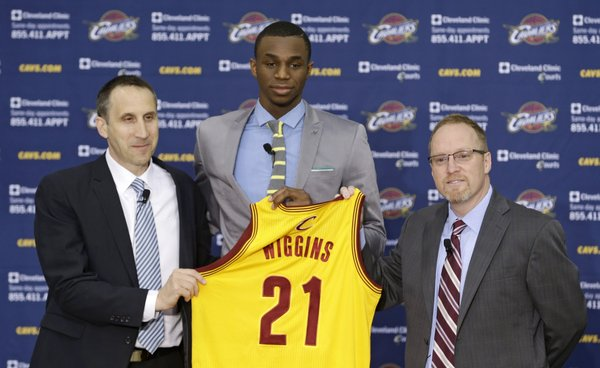 Cleveland Cavaliers head coach David Blatt, left to right, Andrew Wiggins and general manager David Griffin hold up Wiggins jersey during a new conference Friday, June 27, 2014, in Independence, Ohio.
