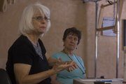 Vicki Julian (left) talks about her experiences with death as Tammy Sabol listens in at a recent meeting of the Lawrence Death Cafe at Personal Power Pilates Studio, 3115 W. Sixth St.