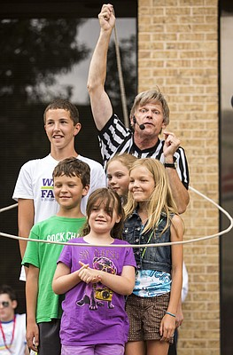 Juggler and performer Brain Wendling spins a lasso around himself and five volunteers during  his performance in the 900 block of Massachusetts Street as part of the Free State Film Festival, Saturday afternoon, June 28, 2014.