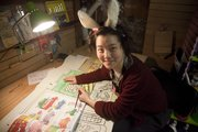 Toy Store assistant manager and artist Grace Chin works on a window display for the store last year.