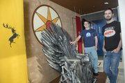 """Artists Scott Burr, left, and Tyler Snell collaborated to create a """"Game of Thrones"""" window display at Game Nut, 844 Massachusetts St."""