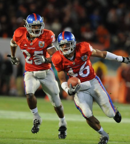 In this photo from Jan. 3, 2008, Kansas University's Darrell Stuckey, left, trails teammate Justin Thornton as Thornton brings an interception upfield against Virginia Tech during KU's Orange Bowl victory.