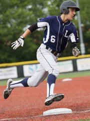 Lawrence Raiders' Nolan Prochaska rounds third base, heading for home during the Raiders' game against the Salina Sliders, played Thursday at Free State.
