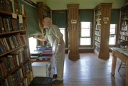 Last week Ray Wilber, of Baldwin, a historic preservationist, opens windows at the Coal Creek Library in Vinland. Community volunteers such as Wilber share duties opening the library from 1 to 4 p.m. Sundays from April through October.