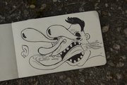Graffiti artist Matthew J Asbury sketches the cartoon characters that he paints in the streets of Kansas City.