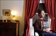 """In this Journal-World photo from March 2003, Christine Kaplan holds a framed portrait of her son, Sean Heskew. Heskew, then 22, was stationed in the Persian Gulf with the Marines. """"This is a parent&squot;s worst nightmare,"""" Kaplan said in 2003, shortly before the U.S. launched its first invasion into Iraq. Police were dispatched to her home in the 1100 block of New York Street early Saturday afternoon to investigate a body found on the premises. Police are considering the death a homicide."""