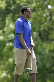 Miami Heat point guard and former Kansas University standout Mario Chalmers watches a practice tee shot during the Sixth Annual Mario V. Chalmers Foundation Golf Tournament & VIP Mixer at Alvamar Golf Club Monday.
