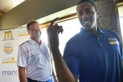 Miami Heat point guard and former Kansas University standout Mario Chalmers, right, and KU basketball coach Bill Self joke during the Sixth Annual Mario V. Chalmers Foundation Golf Tournament & VIP Mixer Monday at Alvamar Golf Club.