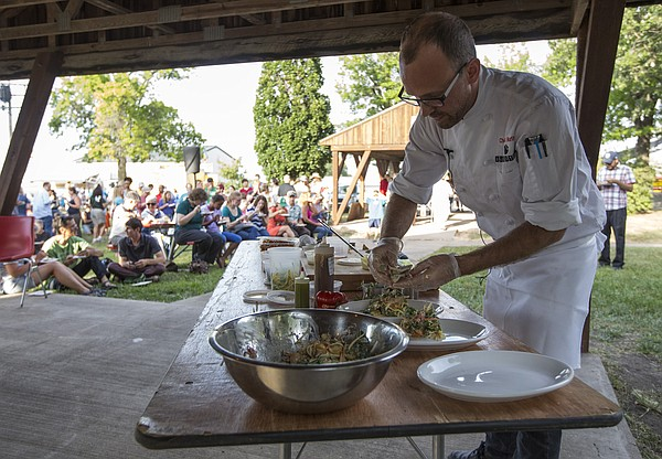 Rick Martin, head chef and owner of Limestone Pizza, plates his pork carnitas chopped salad served with the flat bread as he participates in the fourth annual Chef's Challenge on Wednesday, July 30, 2014, at the Douglas County fair. Martin won first place with his dish.