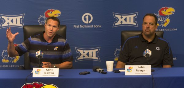 Defensive coordinator Clint Bowen and offensive coordinator John Reagan field questions from the media to open Kansas University's 2014 fall football camp on Thursday August 7, 2014.