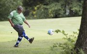 Sports editor Tom Keegan makes a shot from the rough during a game of FootGolf.