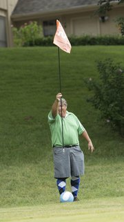 Sports editor Tom Keegan sites a shot while playing FootGolf at the Orchards Golf Course.