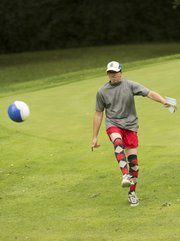 "Chad Lawhorn looks to make a shot in a new game in town, ""FootGolf,"" at the Orchards Golf Course."