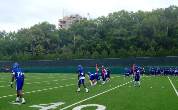 Quarterback Montell Cozart communicates with his offense during a drill at Saturday's practice.