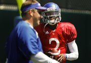 Kansas quarterback Montell Cozart has a laugh with quarterbacks coach Ron Powlus during practice on Monday, August 11, 2014 at the practice fields.