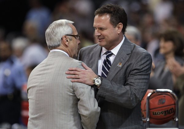 North Carolina coach Roy Williams and Kansas coach Bill Self greet each other before the NCAA men's college basketball tournament Midwest Regional final Sunday, March 25, 2012, in St. Louis. Kansas, where Williams coached for 15 years, defeated North Carolina 80-67.