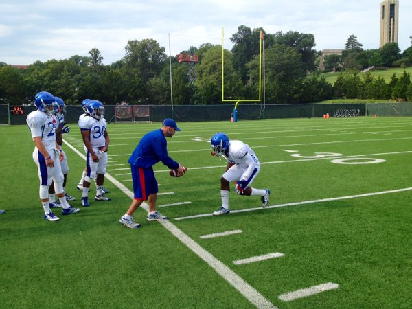 Safeties coach Scott Vestal works with SS Isaiah Johnson during a drill at Friday's morning practice.