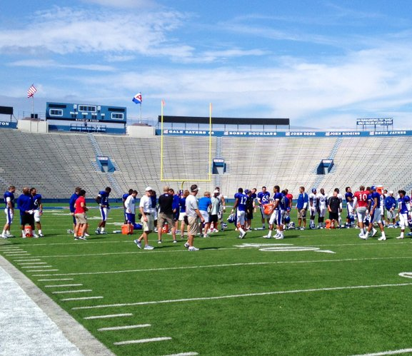 Players and coaches line up at the 50-yard line for another round of the ALS Ice Bucket Challenge in which the players dumped ice water on the KU assistants and support staff at the end of practice.