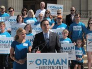 Greg Orman, right, an independent candidate for the U.S. Senate in Kansas, discusses his campaign during a news conference inJuly 2014, as his wife, Sybil, watches to his left on the south steps of the Statehouse in Topeka. Orman is portraying himself as the leading challenger for Republican Sen. Pat Roberts' seat.