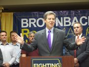 Gov. Sam Brownback vowed Monday that if he is re-elected, he will continue battling the federal government over issues such as environmental protection, health care and gun rights. Brownback spoke at a small gathering at the Wichita Area Builders Association.