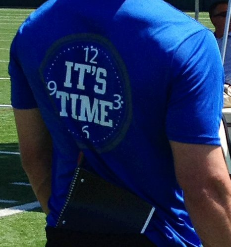 "A Kansas staff member wears one of the Jayhawks' ""It's Time"" T-Shirts made for the 2014 season."