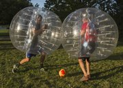Alex O'Nelio, left and Zak Bucia demonstrate bubble soccer on Monday, Aug. 18, 2014.