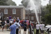 Sigma Chi fraternity residents and other KU students watch as firefighters respond to a structure fire at Sigma Chi fraternity house, 1439 Tennessee, just before noon on Tuesday. Crews had the fire under control by 12:30 p.m. and were continuing to look for hot spots as smoke cleared.