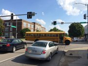 A school bus sits in the intersection of 14th and Massachusetts streets after a car accident, Thursday, Aug. 28, 2014. The children on the bus were not injured.