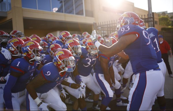 The Kansas Jayhawks hold themselves back before bursting onto the field prior to kickoff against Southeast Missouri State on Saturday, Sept. 6, 2014 at Memorial Stadium.