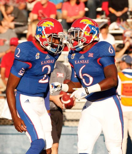 Kansas quarterback Montell Cozart celebrates a touchdown by running back Corey Avery against Southeast Missouri State during the first quarter on Saturday, Sept. 6, 2014 at Memorial Stadium.
