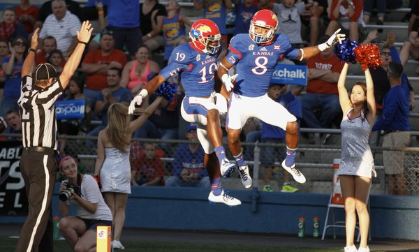Kansas receivers Justin McCay (19) and Nick Harwell (8) celebrate Harwell's first touchdown of the game against Southeast Missouri State during the first quarter on Saturday, Sept. 6, 2014 at Memorial Stadium.