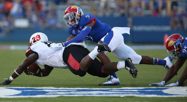 Kansas safety Fish Smithson brings down Southeast Missouri State running back Lewis Washington during the first quarter on Saturday, Sept. 6, 2014 at Memorial Stadium.