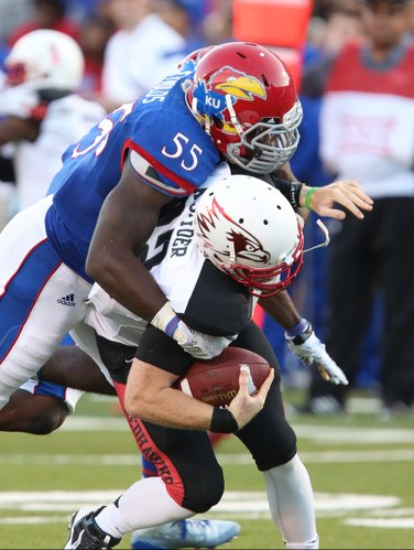 Kansas buck Michael Reynolds drops Southeast Missouri State quarterback Kyle Snyder for a loss during the first quarter on Saturday, Sept. 6, 2014 at Memorial Stadium.