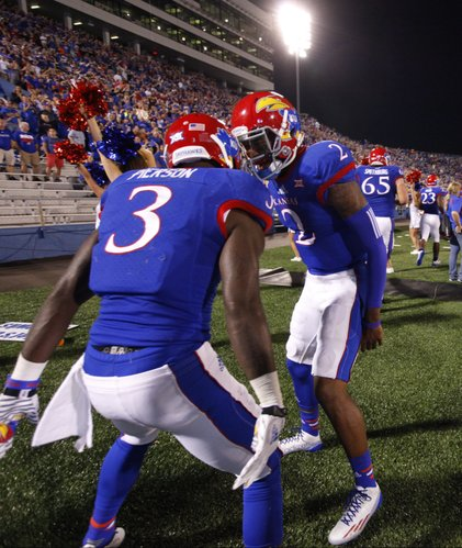 Kansas quarterback Montell Cozart celebrates with receiver Tony Pierson after the two connected for a touchdown against Southeast Missouri State during the third quarter on Saturday, Sept. 6, 2014 at Memorial Stadium.