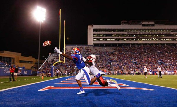 Kansas receiver Justin McCay can't quite get to a pass as Southeast Missouri State cornerback Reggie Jennings covers him on an end zone pass during the third quarter on Saturday, Sept. 6, 2014 at Memorial Stadium.
