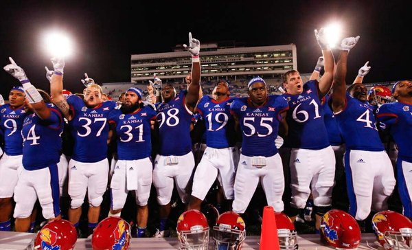 The Kansas Jayhawks sing to the student section after fending off a late charge by Southeast Missouri State to win 34-28 on Saturday, Sept. 6, 2014 at Memorial Stadium.
